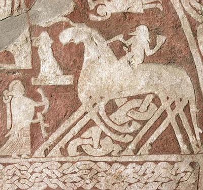 Odin på hesten Sleipner. Ovenover flyver en valkyrie.